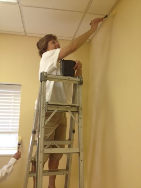 Photo of Jayne Bradley painting at We Care